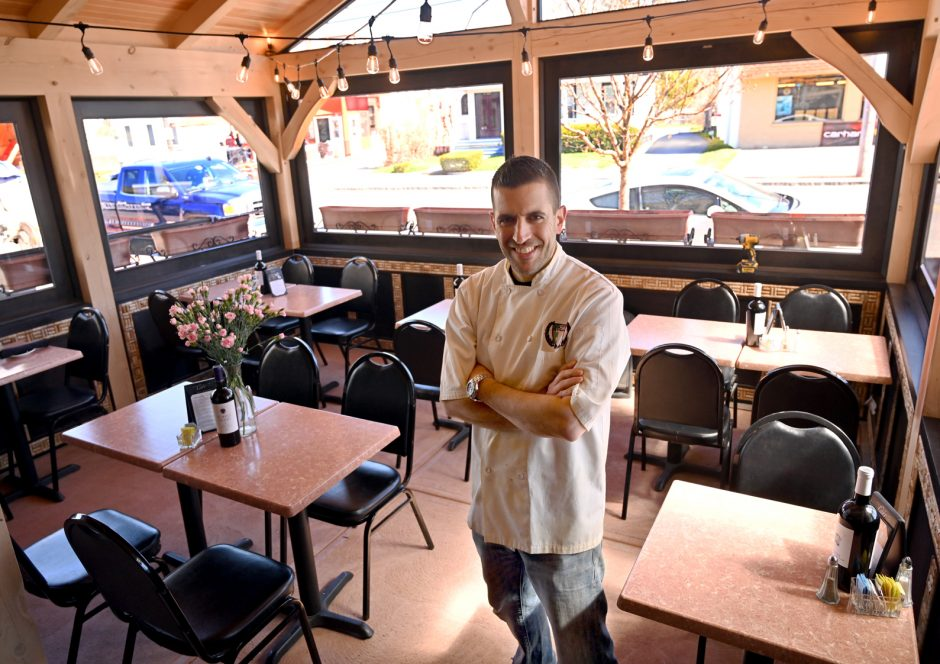 Owner of Scotti's Restaurant & Pizzeria, Guy Sementilli in the new front room patio that was built recently.