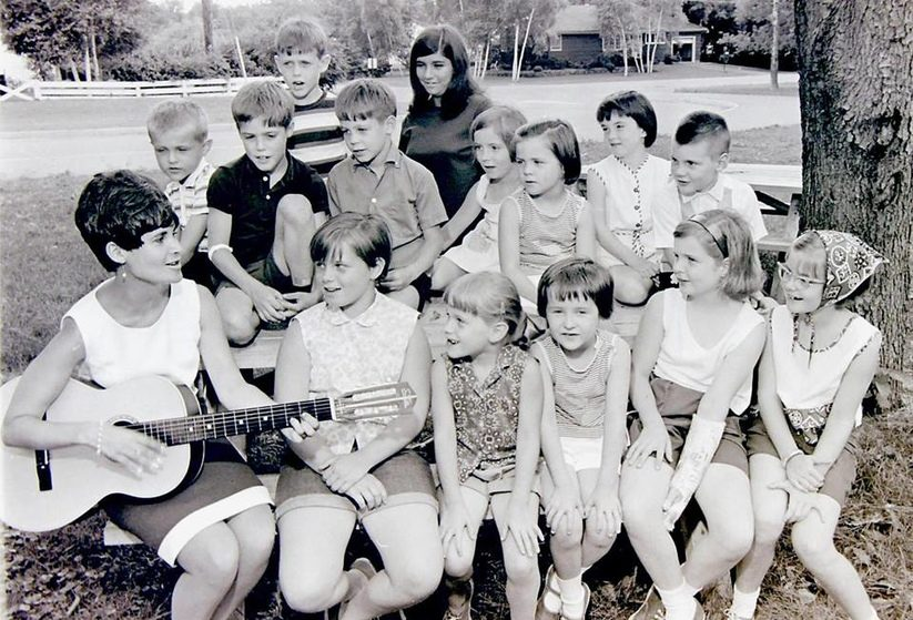 Jane Golub plays guitar and sings along with kids from Niskayuna's Hillside Elementary School area in July 1967.