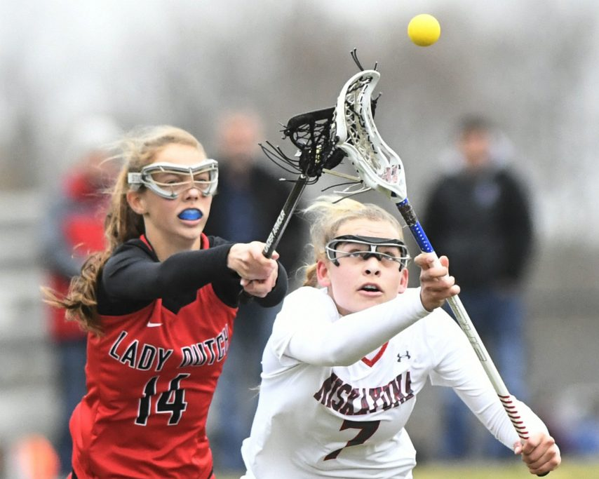 Ava Schroeder of Niskayuna, right, and Jane Leader of Guilderland battle for the ball in Thursday's lacrosse game.