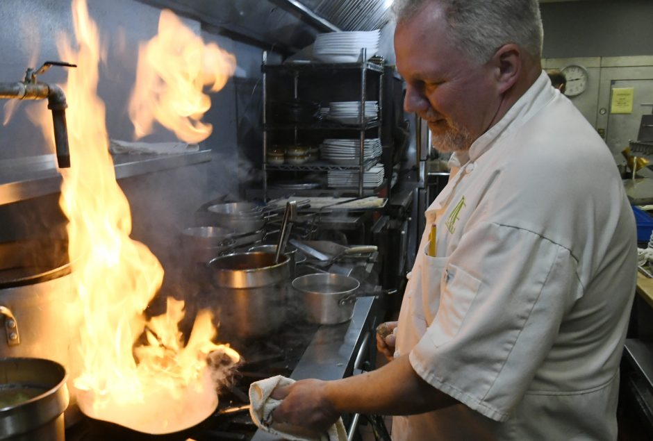 Chef Tom Gallant prepares Seared Scallops at the Turf Tavern in Scotia Wednesday, April 17, 2019.