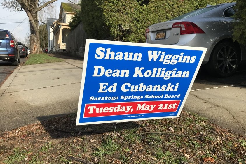 Lawn signs for the school board slate of Shaun Wiggins, Dean Kolligan and Ed Cubanski are popping up in Saratoga Springs.