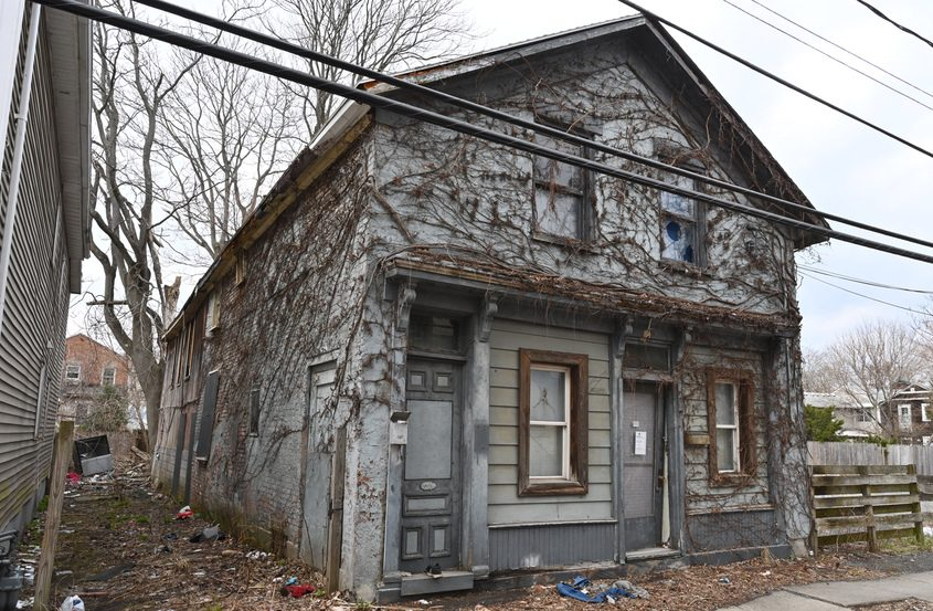 A rundown house at 16 Jefferson St. in Schenectady is pictured.