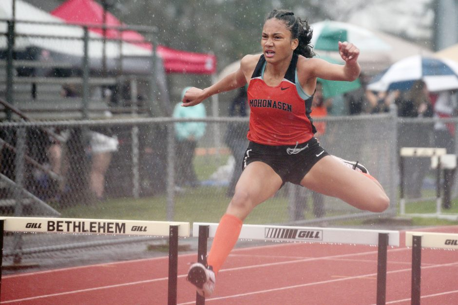 Mohonasen's Natalia Sawyer runs to victory in the 300-meter hurdles during the 14th annual Lady Eagles Invitational Saturday.