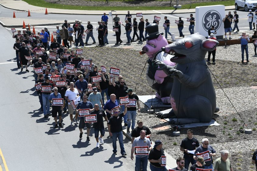 General Electric Union workers hold a rally in front of the main plant on Edison Avenue in Schenectady Tuesday.