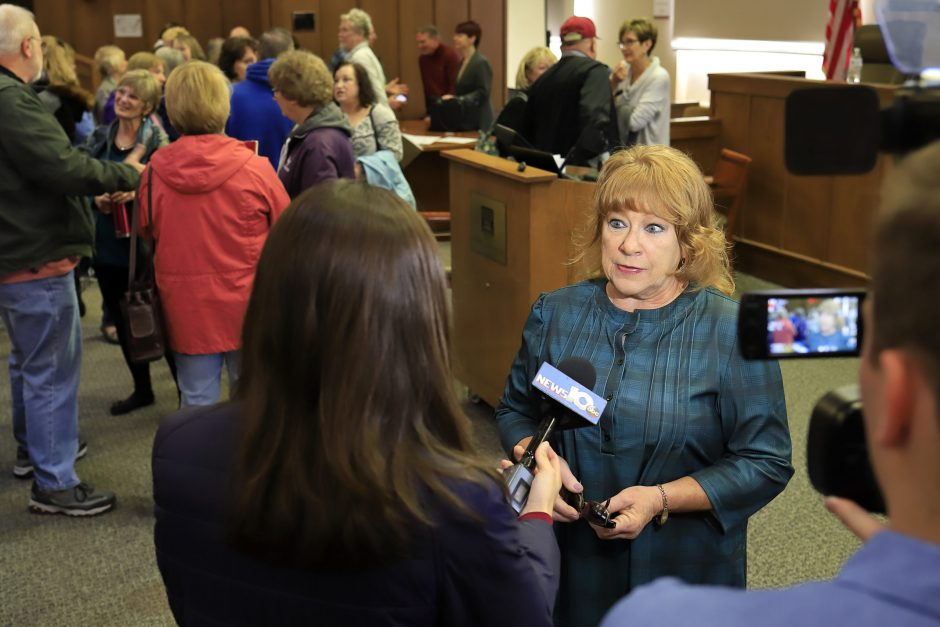 Employees committee co-chairwoman Mary Hartshorne talks with media after Saturday's session.
