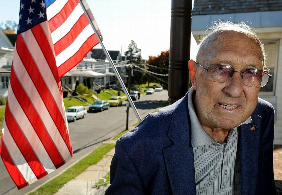 Frank Duci stands on the front porch of his former Schenectady home on Avenue A in 2009.