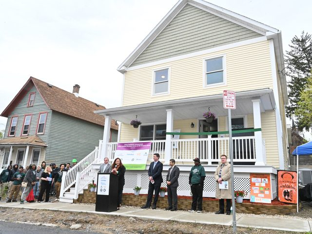 SEAT Executive Director Jennifer Lawrence speaks at the ribbon-cutting for the completed YouthBuild home at 99 Prospect St.