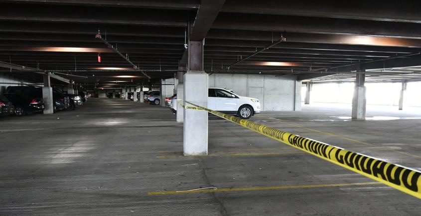 A section of the parking area in the lower level parking garage at 220 Harborside Drive is taped off Friday.