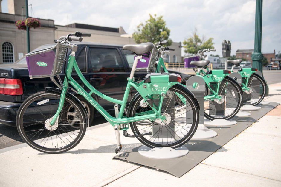 Ride-share bicycles are lined up in front of the Schenectady County Public Library on Clinton Street.
