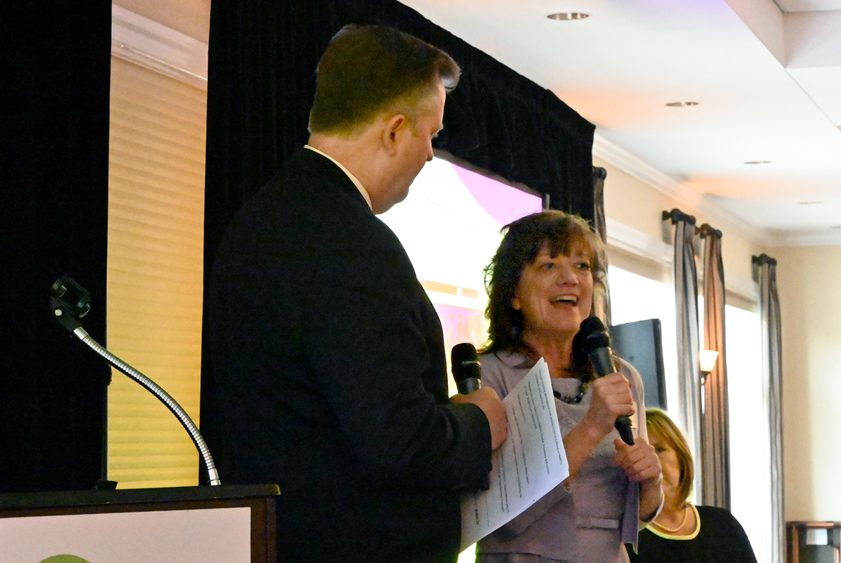Debbie Fowler, founder of Eyes Wide Open NENY, talks to master of ceremonies Greg Floyd.