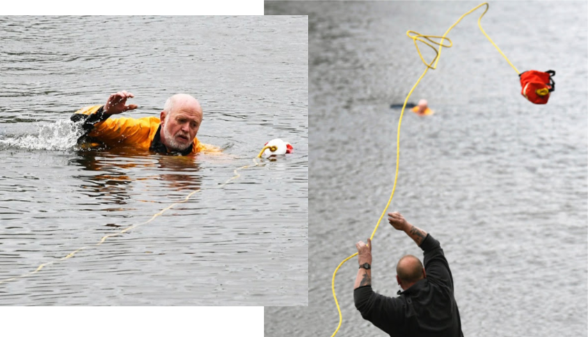 Dan Brudos grabs a rescue rope as he pulls a drowning victim to shore from the Mohawk Thursday.
