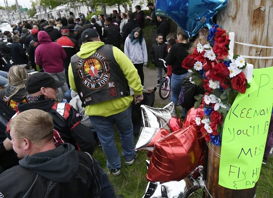 Hundreds gathered to honor John Keenan III at the intersection of Elder and Albany streets Thursday, May 9, 2019.