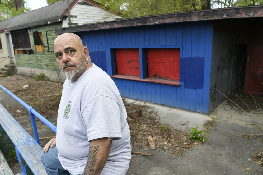 Ed Varno, who lives on Fourth Street, sits on the bleachers with the club house and snack bar behind him last week.