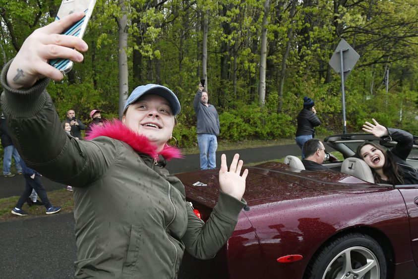 Julie Anne Johnson of Albany takes a selfie with American Idol star Madison Van Buren, in car waving, during a parade.
