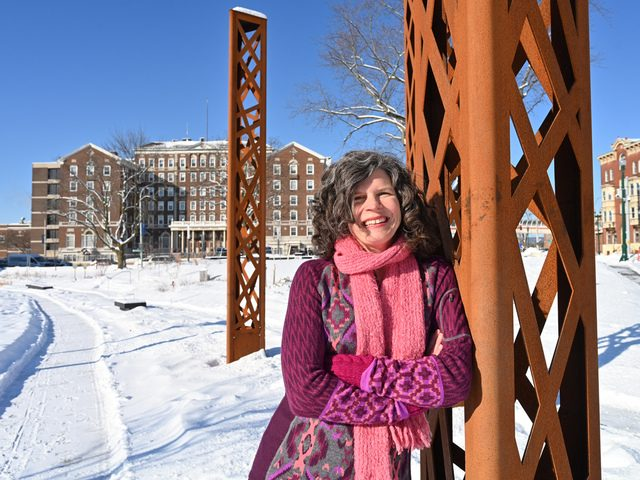 Mary Moore Wallinger, founding principal of LAandArt Studio poses for a photo in Schenectady's Gateway Plaza.