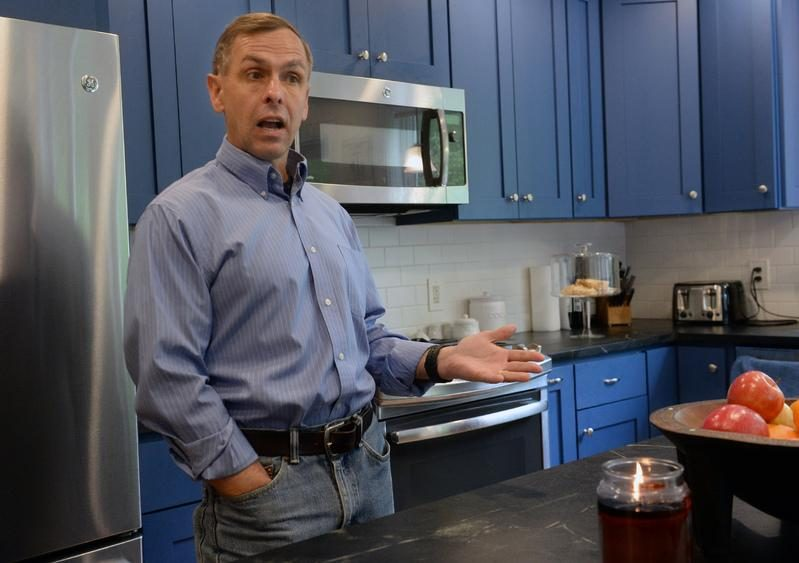 Then-candidate Robert Smullen stands in the kitchen of his Johnstown home.