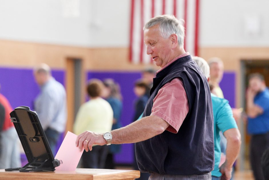Jim Mraz casts his vote for the Board of Education election and budget at Johnstown High School in Johnstown on Tuesday.