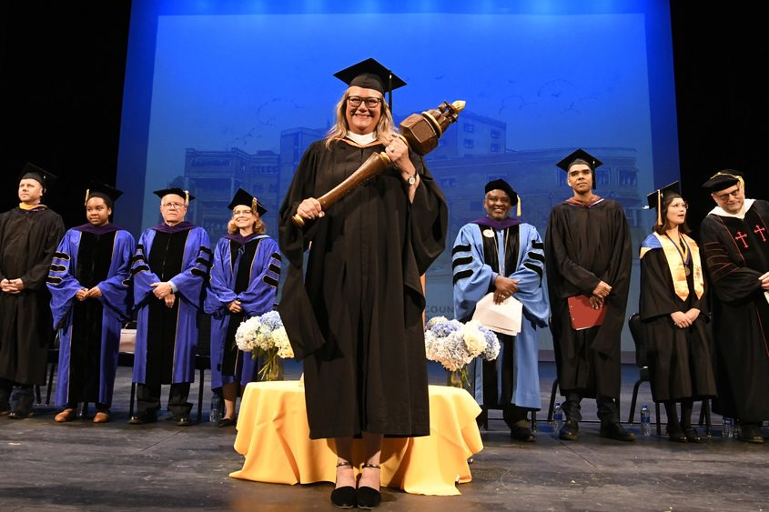 SUNY Schenectady Grand Marshall Kim Otis stands in front at Proctors for the college's 49th commencement Thursday.
