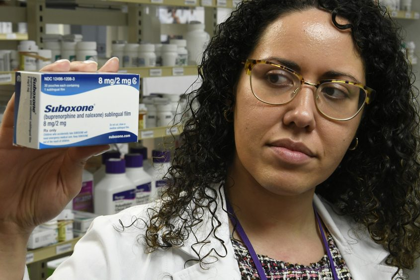 Dr. Cristine Espinosa holds a box of Suboxane Friday that is prescribed to heroin addicts to help their addiction.