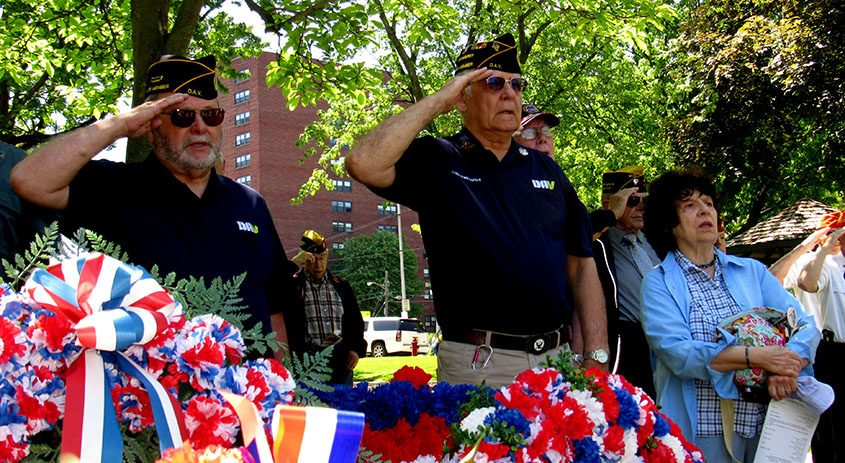 From left, Bob Serotta, an Army veteran, and Navy veteran Jim Bleser and his wife Jane stand in Veterans Park in Schenectady.