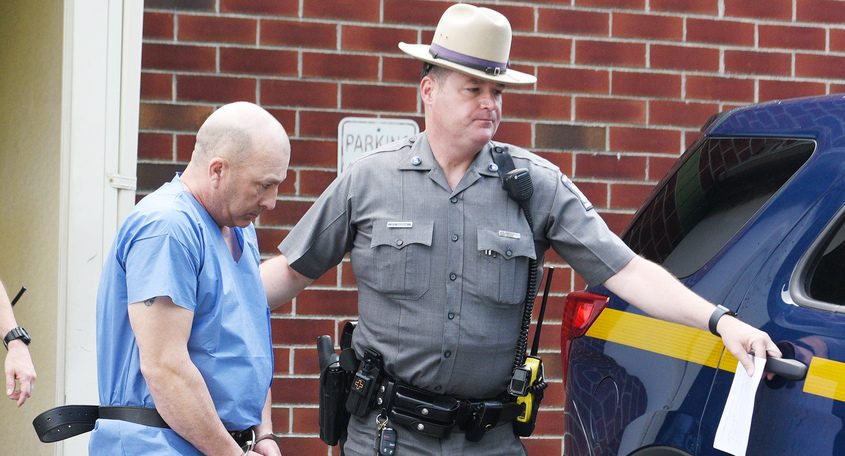 Defendant Dickie WInn is led from Clifton Park Town Court Sunday