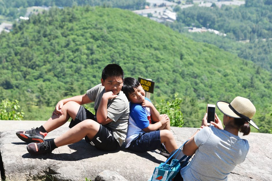 William and John Henry Zhang of Clifton Park pose for a photograph at the top of Prospect Mountain on June 9, 2019.
