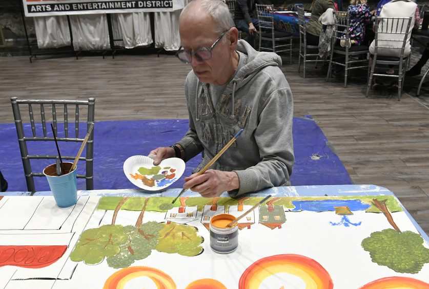 Paul Spencer of Ballston Lake paints at the Groovin4 Gateway Park at Key Hall in Proctors Tuesday.