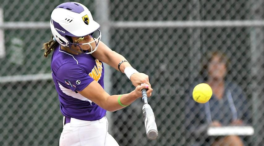 Ana Gold hits a home run in Tuesday's championship game.
