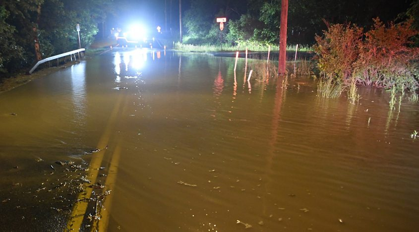 Water fills the intersection of Mohawk and Rosendale roads after a 20-inch water main break late Tuesday