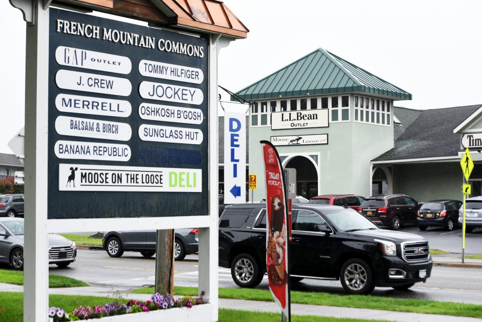 Visitors browse the various stores the French Mountain Commons outlets in Lake George on Saturday, June 2, 2019.