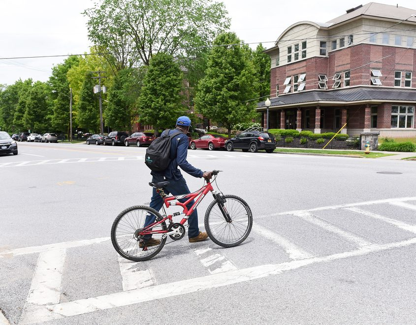 Pedestrians cross over Union Ave at Regent Street in Saratoga Springs on Thursday.