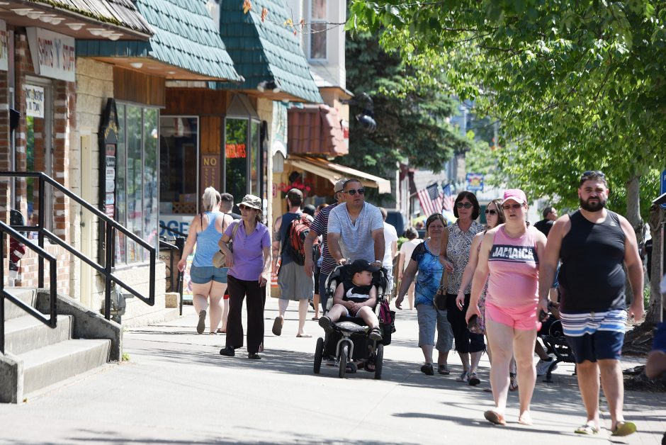 People enjoy the nice weather on Canada Street in the Village of Lake George in Lake George on Sunday, June 9, 2019.