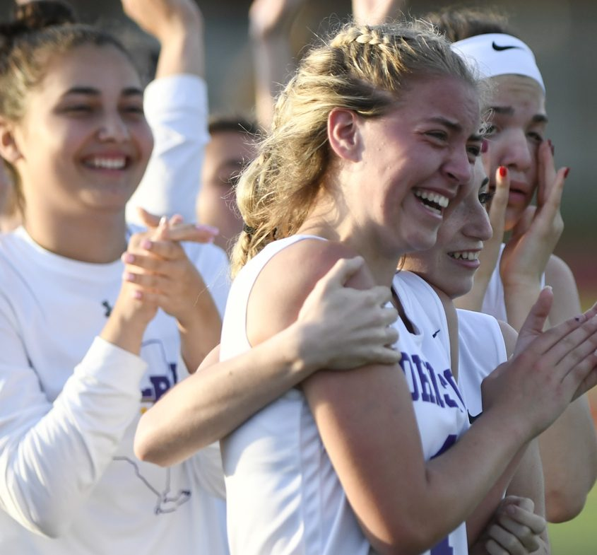 Johnstown's Taryn Ringer, center, cries tears of joy with teammates after a crucial win May 23.