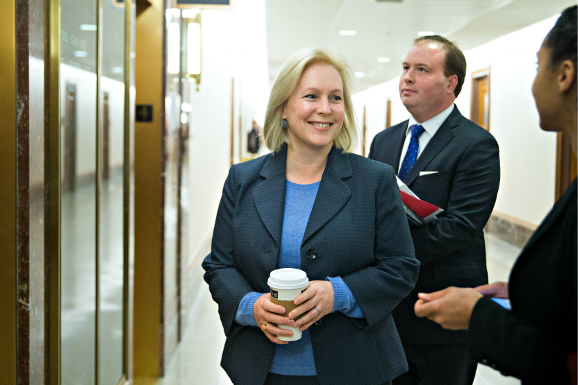 Sen. Kirsten Gillibrand (D-N.Y.) talks with staff while waiting for an elevator Jan. 17, 2018.