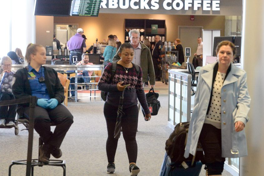 Travelers head for security Monday at the Albany International Airport.
