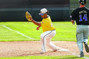 Ballston Spa first baseman Donovan Rhoden records an out in Friday's state semifinal against Sayville.