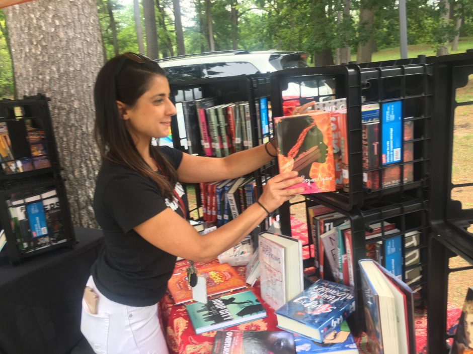 Kristina Graves, a Schenectady City School District librarian, places a book at the bookmobile table.