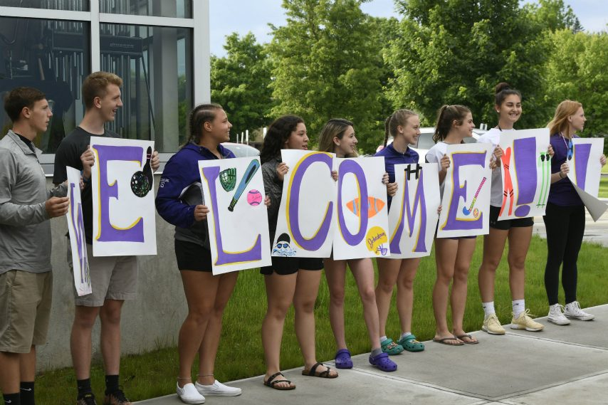 Student-athletes from Johnstown welcome supporters of their sports program Wednesday.