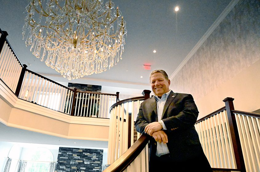 Angelo Mazzone stands inside the renovated Glen Sanders Mansion.