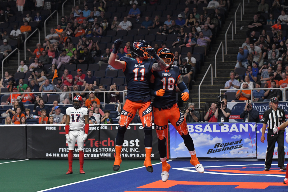 Albany Empire wide receiver Collin Taylor (11) celebrates a touchdown with Quentin Sims during a June 1 game against Washington.