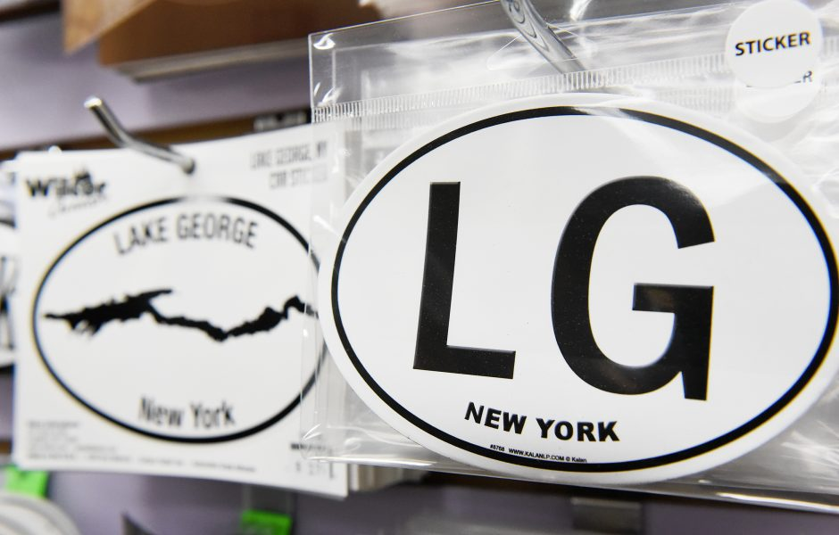 Symbolic Lake George stickers sold at The Lake George Shop on Canada Street in Lake George on Thursday, June 20, 2019.