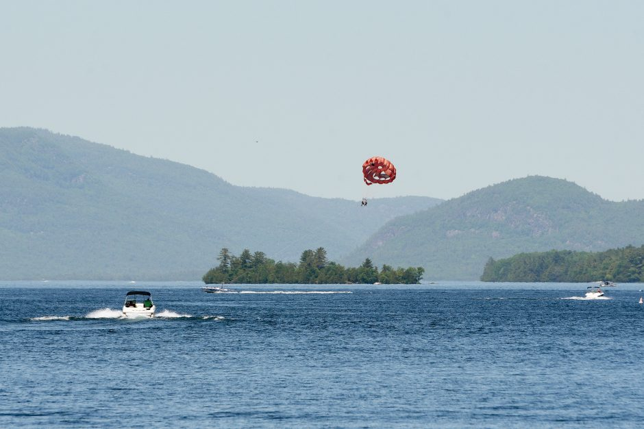 People parasailing by a rental company on Lake George in Lake George on Sunday, June 9, 2019.