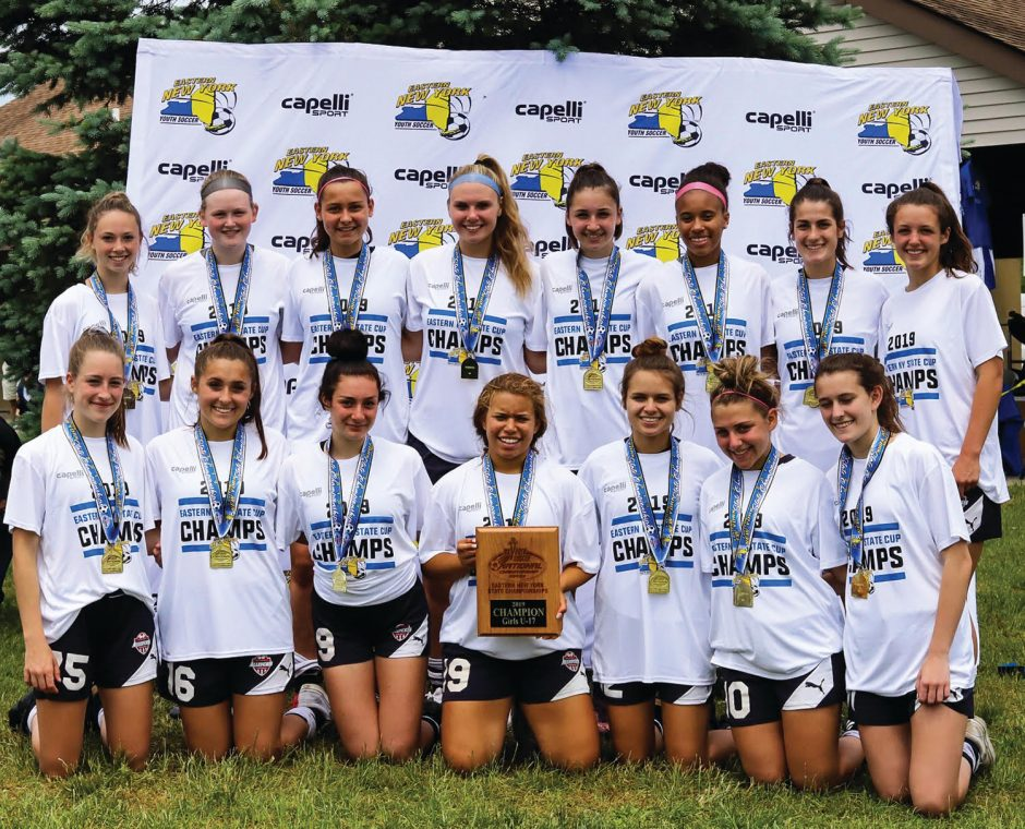 The Albany Alleycats' U17 team displays its Eastern New York Youth Soccer Association State Open Cup championship plaque.