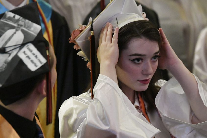 Mohonasen High School graduate Catherine Alesio fixes her mortar board at the 60th Commencement at Proctors Theatre Saturday.
