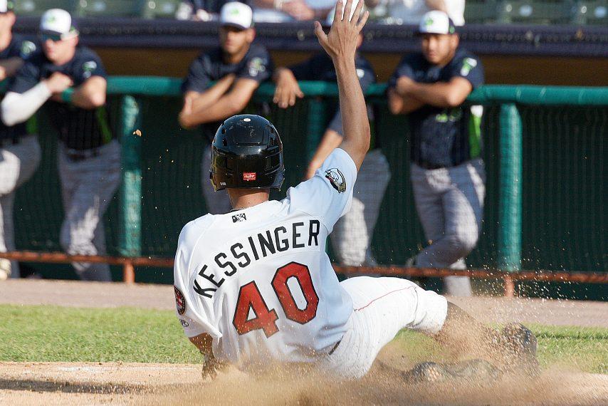 Grae Kessinger slides into home earlier this season.