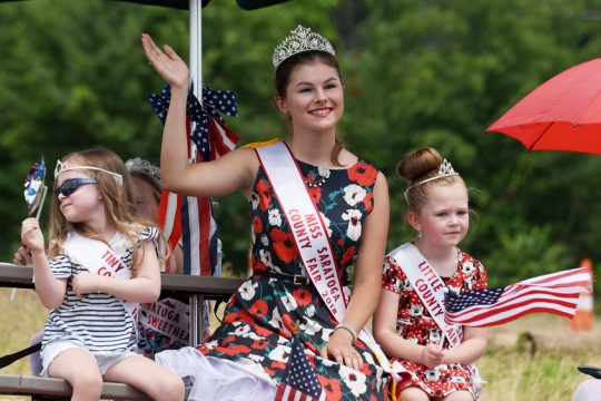 Miss Saratoga County Fair 2018 winners wave during the Clifton Park Fourth of July parade down Route 146.