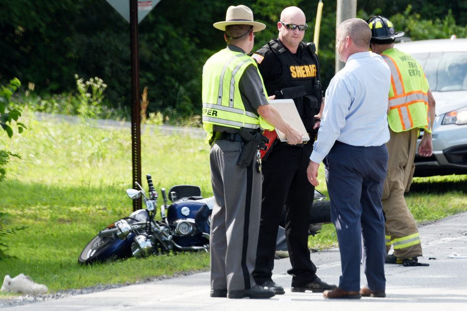 Police investigate a collision between a motorcycle and a car on Friday.