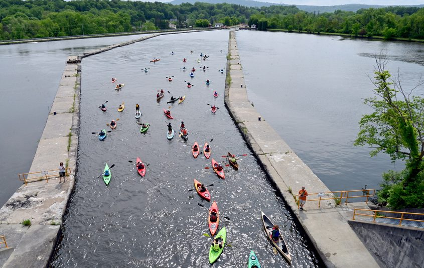 Dozens of paddlers fill the Waterford Flight of Locks on June 2, 2019.