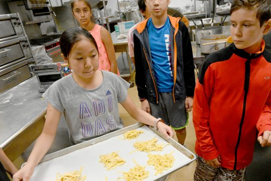 Angella Chen of Niskayuna moves a tin of freshly cut fettuccine to the refrigerator before cooking