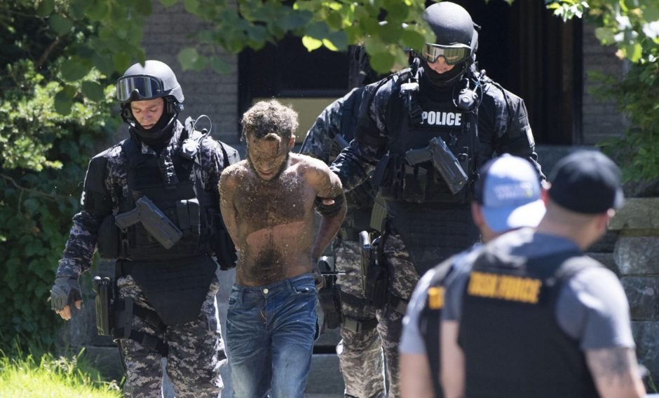 The city police Special Operations Squad takes Fernandez into custody July 1